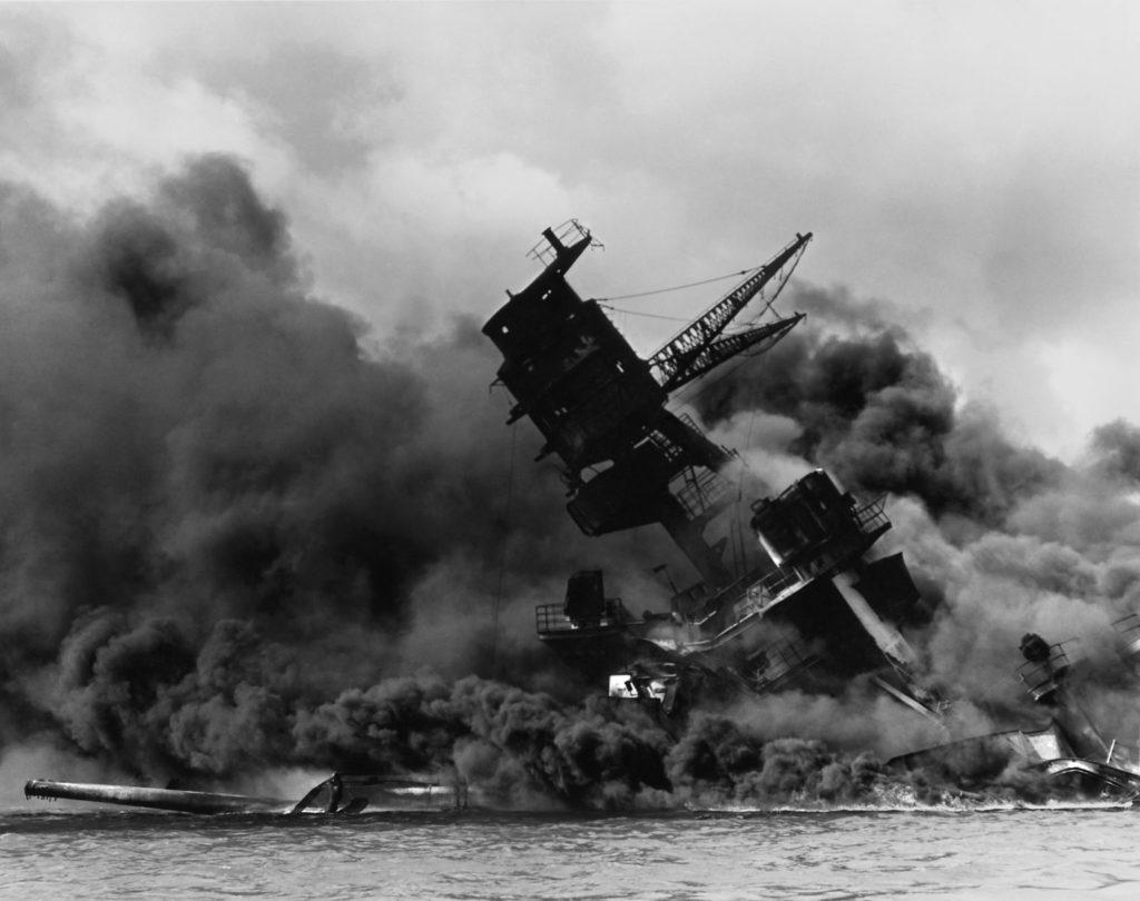USS Arizona (BB-39) burning.